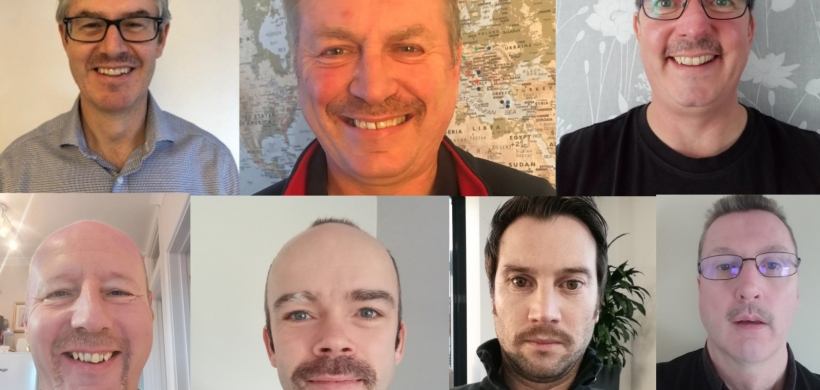 Male LiveWest staff sporting mustaches