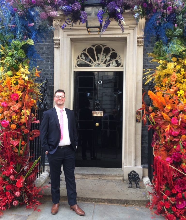 Nathan outside of Number 10 Downing Street during the Pride celebrations in July 2019.