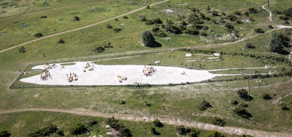 Aerial image of volunteers spreading chalk on Bulford Kiwi