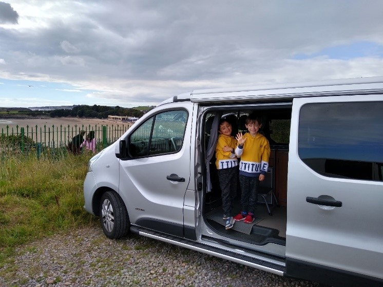 Michael Fletcher's children looking out of camper van