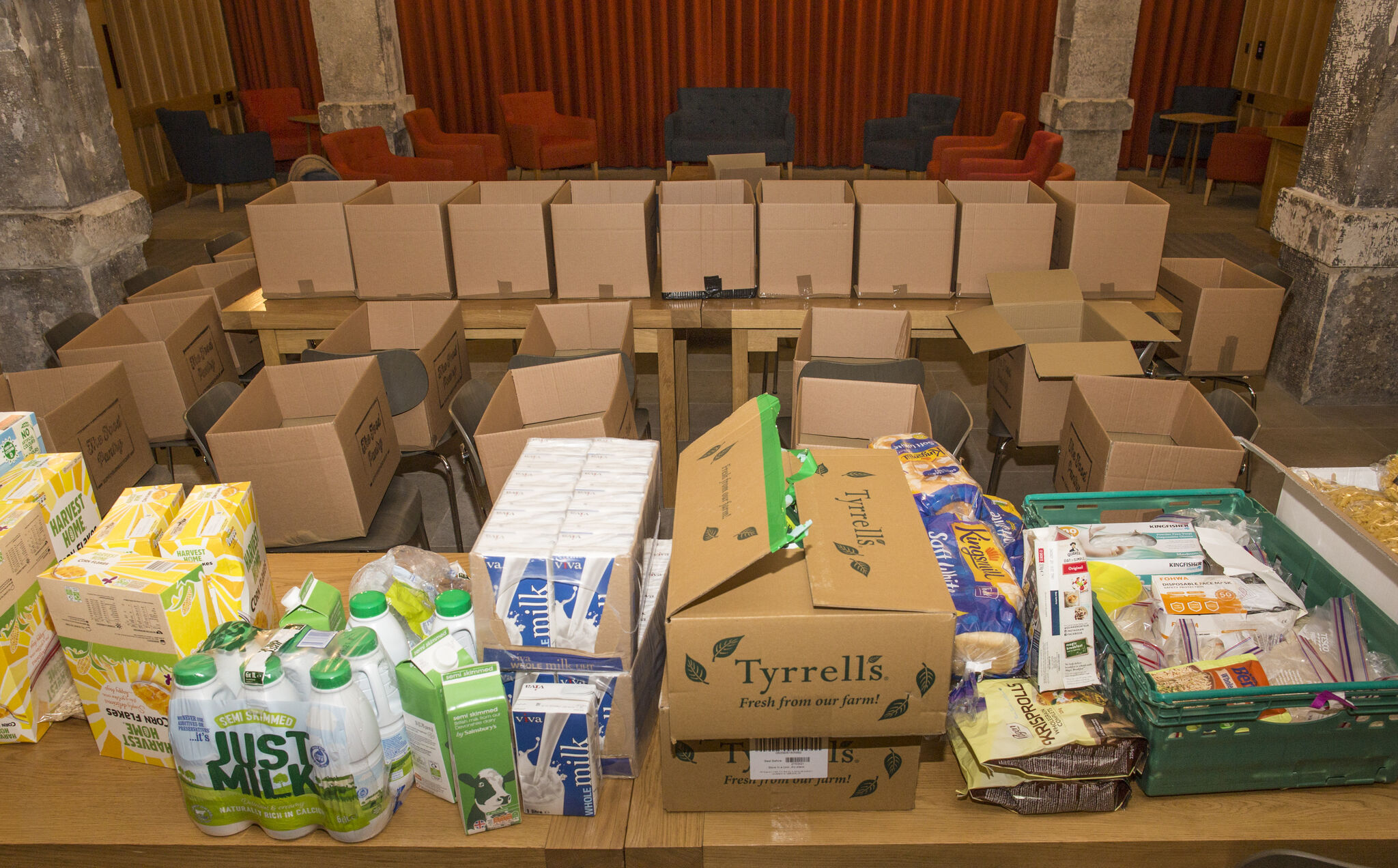 Image of lots of food and boxes as the food parcels are made up
