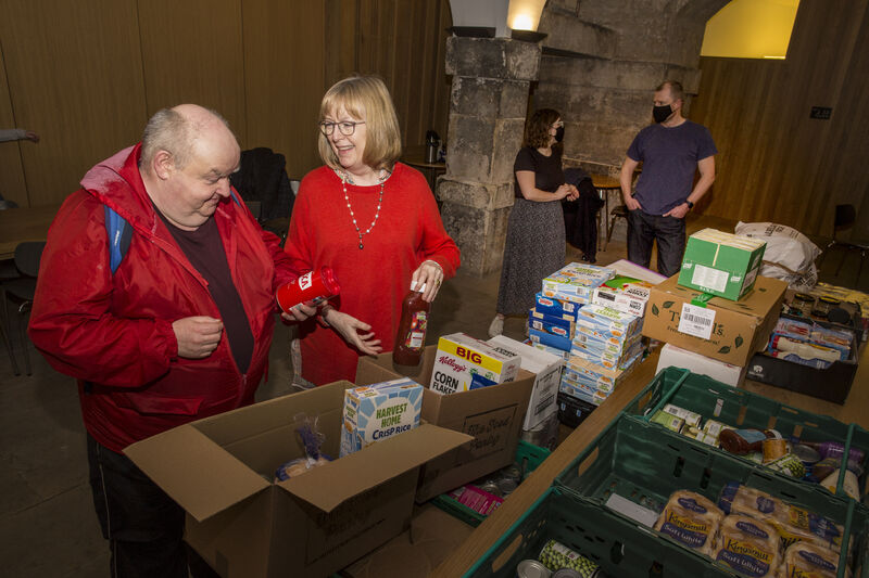 Image of 2 individuals working at the food bank