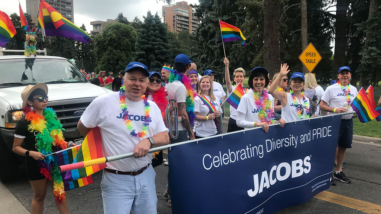 Group of smiling Jacobs employee at a Pride march
