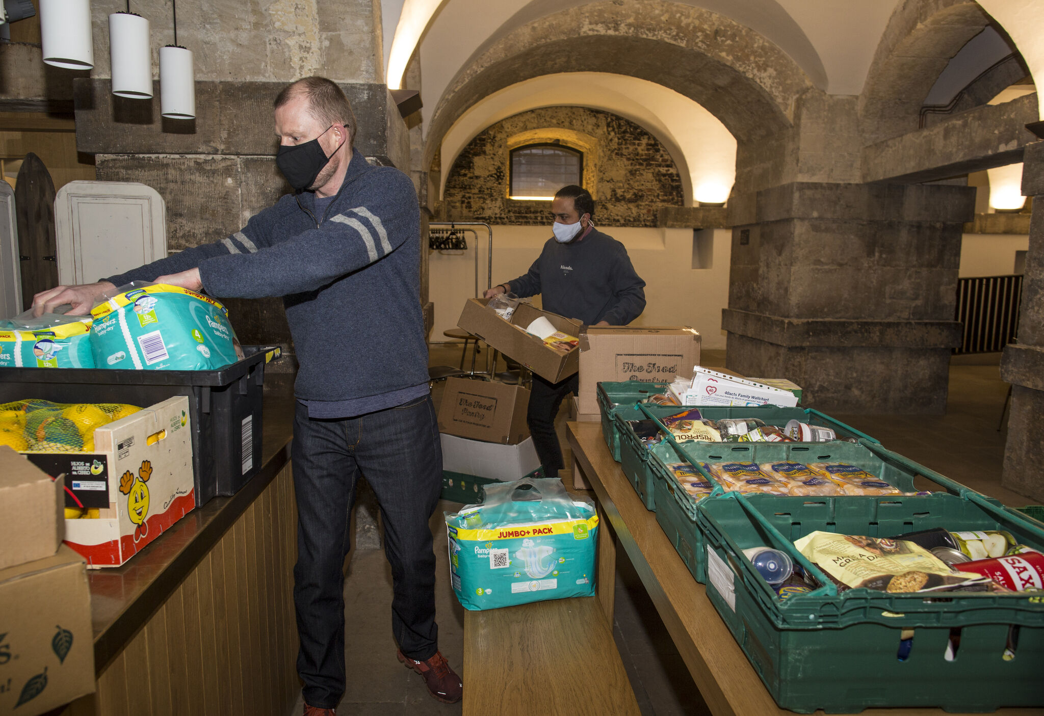 Image of 2 males working in the food bank