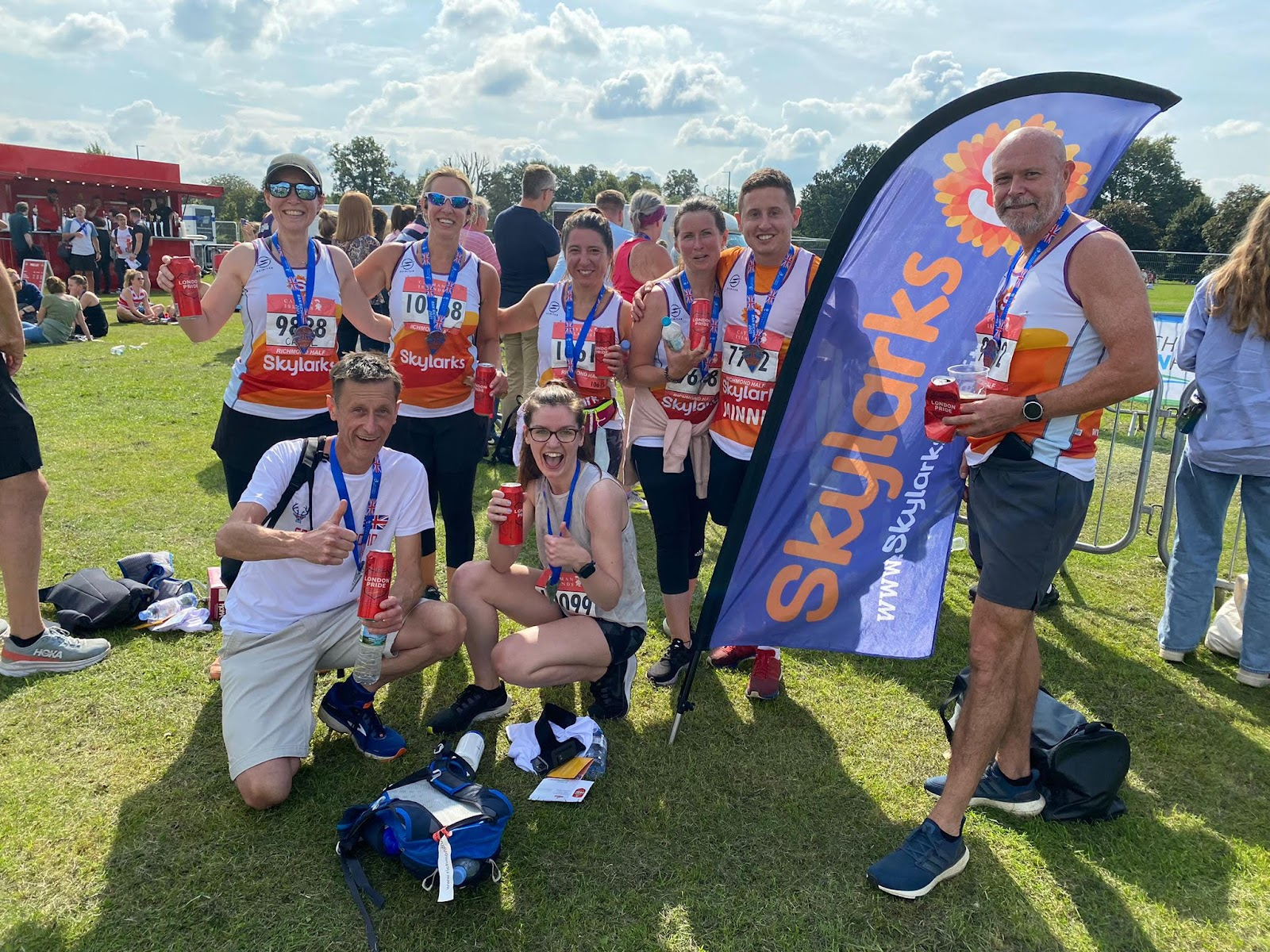 Picture of 8 individuals smiling at the camera having finished a run in Richmond park for charity