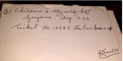 Image of an old piece of paper with Children and myself left Guyana Aug 1964. Ticket number 19587, £200, written on it