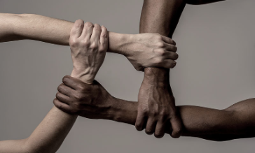 Image of interlocked hands and wrists