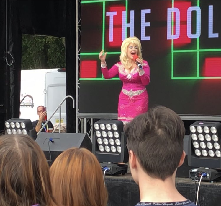 Kelly O'Brien – one of the nation's most revered Dolly Parton impersonators – entertaining the crowd at Leicester Pride 2021.