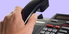 Image of someone's hand picking up phone