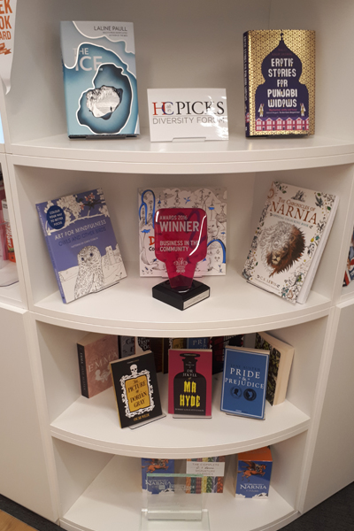Bookcase with HarperCollins BITC Award for Employee Network Group
