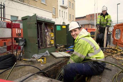 Image of a white male openreach employee working on the cables