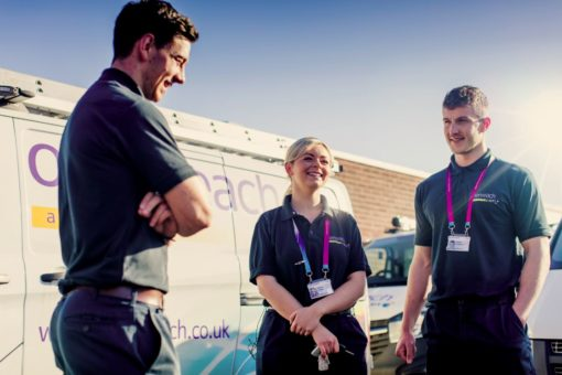 Image of two white male and a white female openreach colleagues by their van