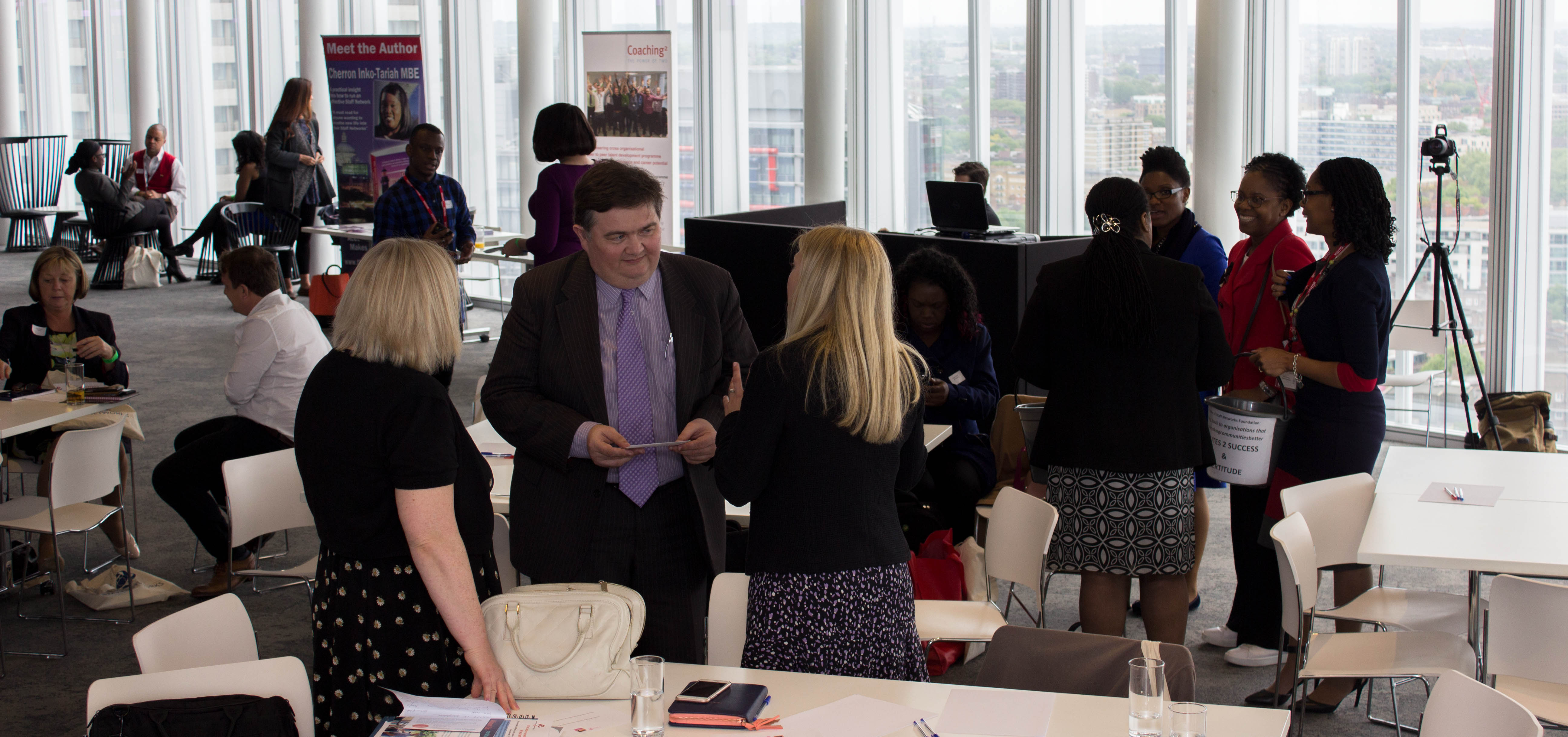 Networking at the event, groups of people of all races, abilities and genders
