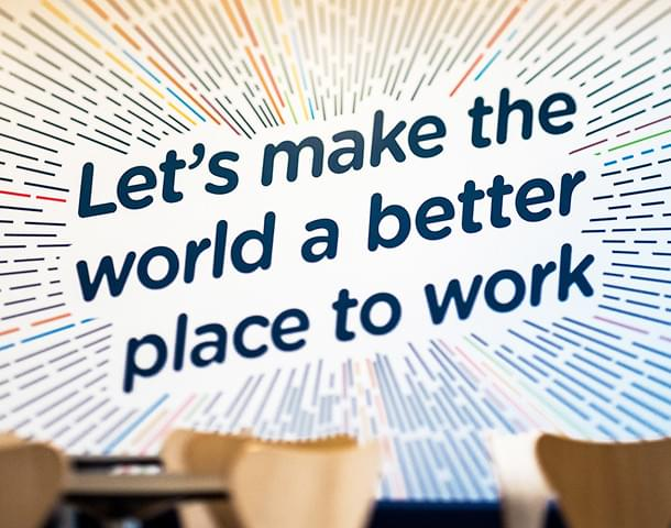 The text 'Let's make the world a better place to work'