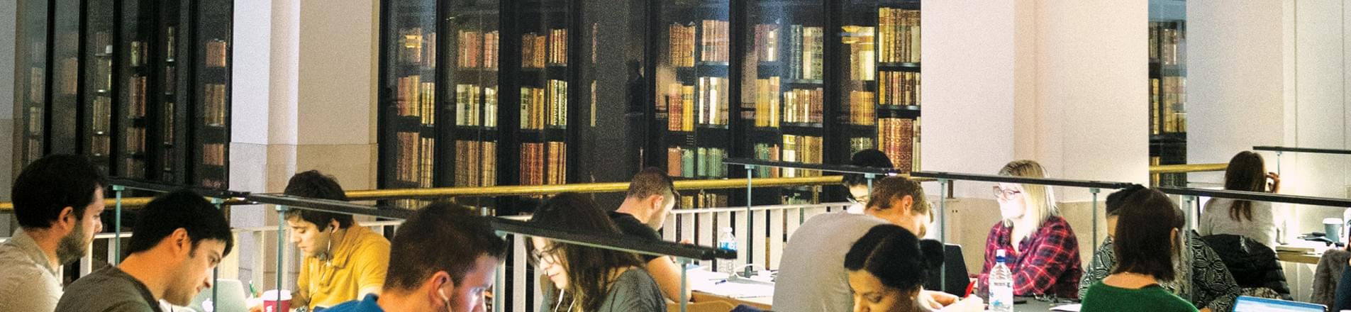 A group of people working in the British Library