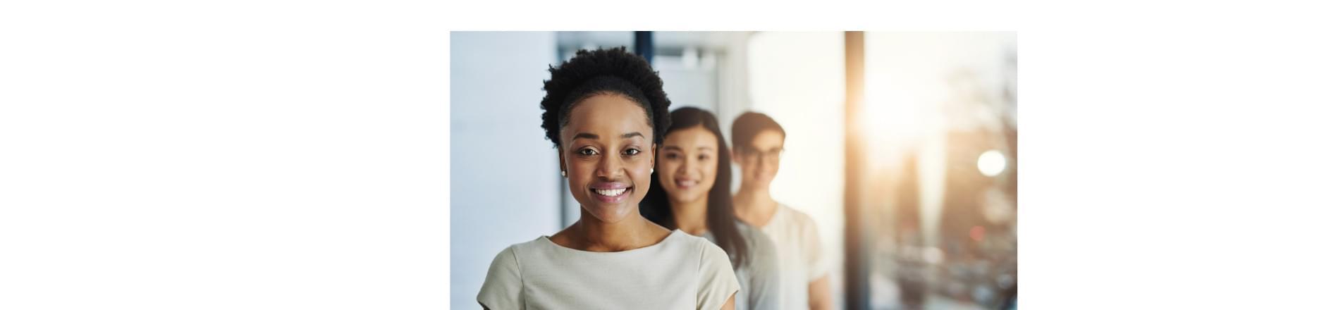 3 diverse woman looking at camera.
