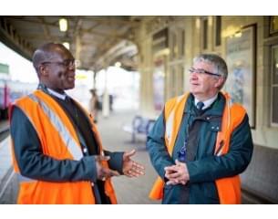 great western employee Black man and white man taking on the station platform