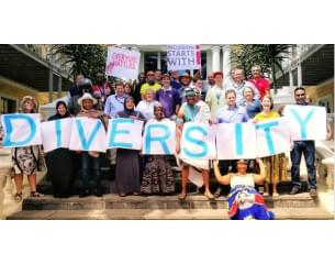 Picture of group of diverse people holding cards with diversity