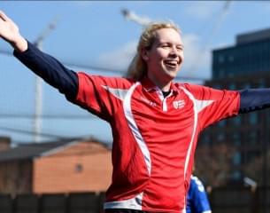 Female player celebrating scoring a goal.