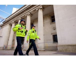 Two police men walking