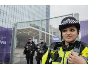 West Midlands Asian Female Police Officer, with x 2 white colleagues who are armed.