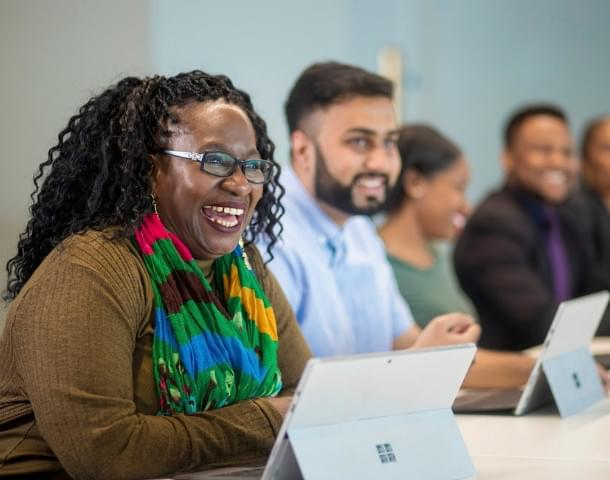 HMRC  black female staff member smiling.