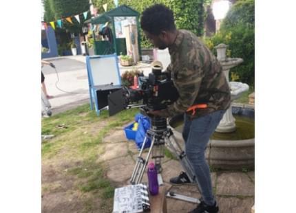 Kadira, a camera crew intern working with the camera
