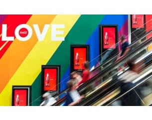 escalator with rainbow color wall with love