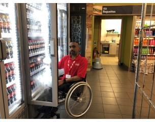 Asian man in a wheel chair