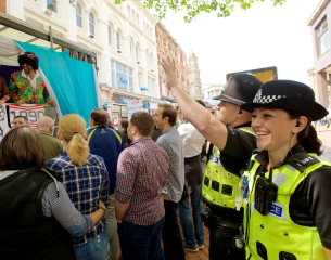 Male and Female Officer on patrol at PRIDE.