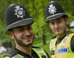 2 male officers on patrol.