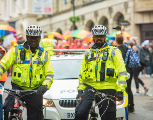 2 officers on the beat using bicycles.