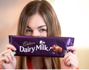women holding cadbury dairy milk bar