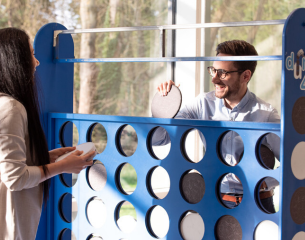two people playing connect 4