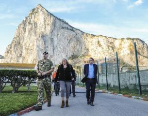 3 members of DIO staff walking at Gibraltar barracks.