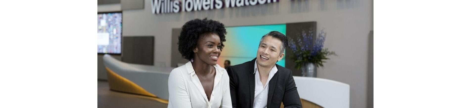 Two people, a african woman and east asian male standing together