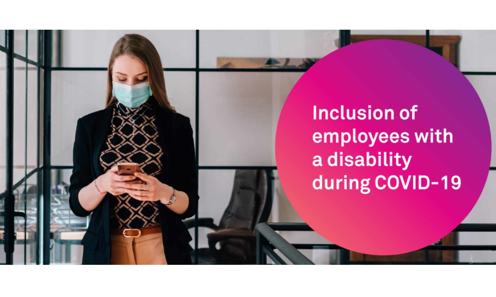 Female employee wearing mask in boardroom setting using mobile device.