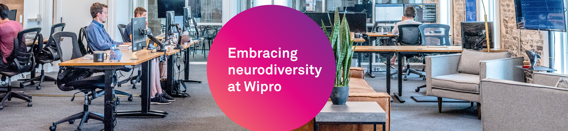 Embracing neurodiversity at Wipro  - Image of 4 males working at terminals within an office setting.