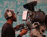 Young person operating a camera