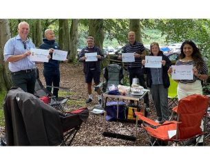 The HouseProud-LGBT pledge to improve services for LGBT+ customer signed by the Executive team celebrated at their socially distanced team picnic.