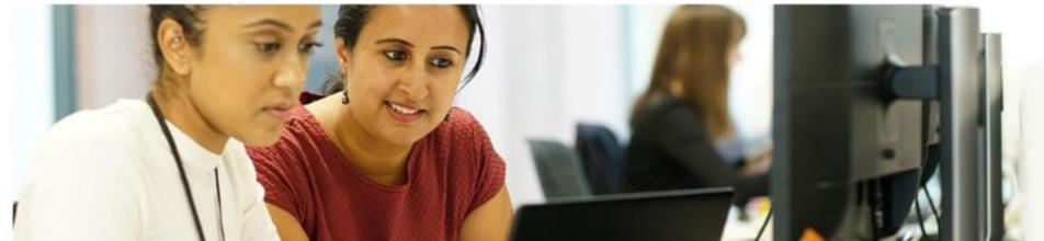 2 female Arcadis employees at computer terminal