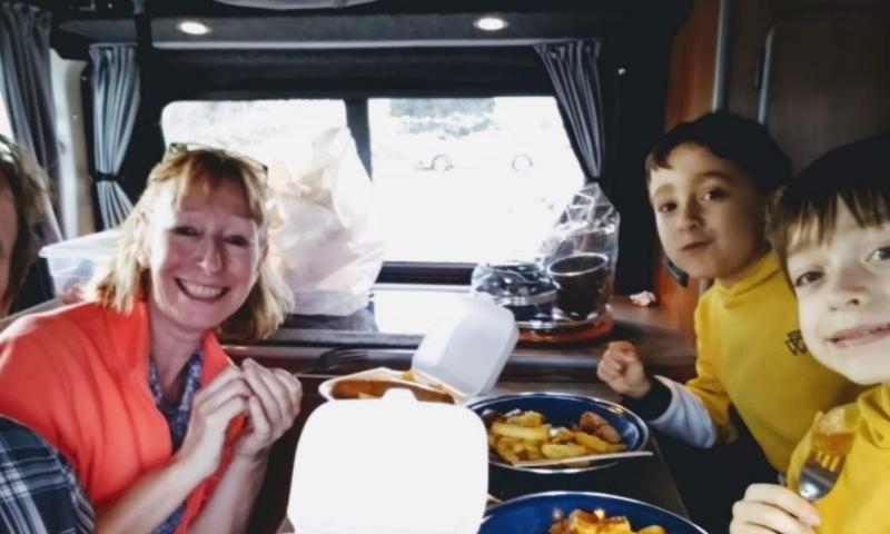 The Fletcher's on holiday eating dinner in their camper van