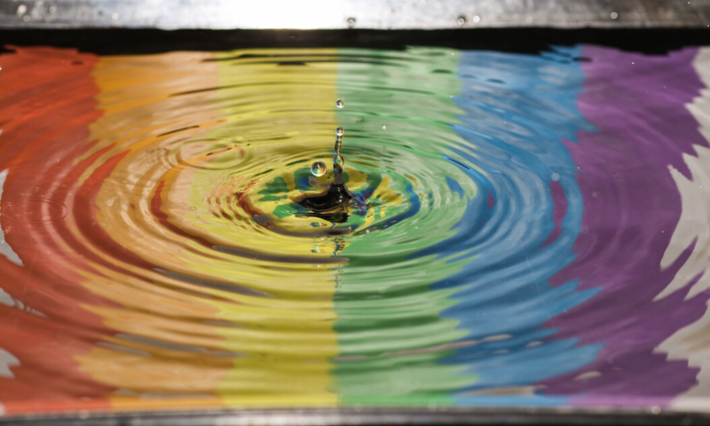 Puddle with rainbow reflection