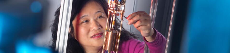 Asian female at NPL conducting quantitative experiment