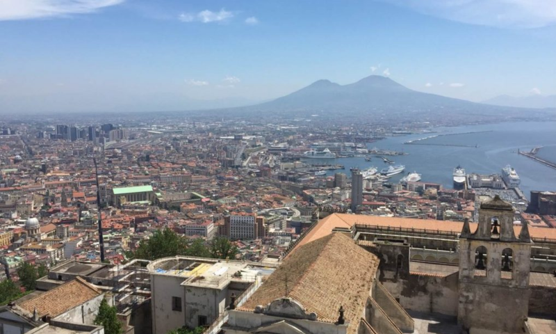 Rooftops of Naples with Vesuvius in the background. [Copyright Simon Evans]