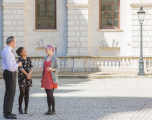 DCMS staff in courtyard at Whitehall building, one male, two female