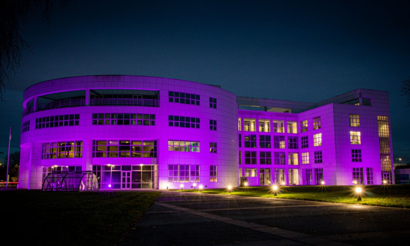 Siemens UK HQ - Manchester, England lit up with purple lights