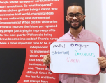 Male Hiscox employee sharing what he enjoys about the work culture