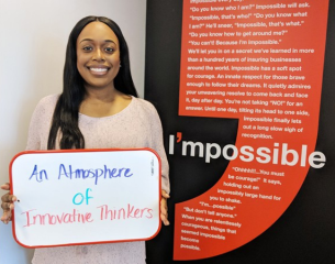 Female Hiscox employee expressing what she enjoys about the work culture