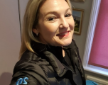 Victoria Coleman wearing Intapp 20th Anniversary Tumi Winter jacket